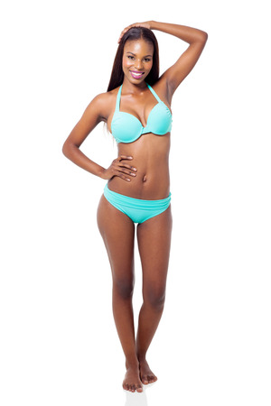 attractive african fashion model posing in swimwear isolated on white background photo