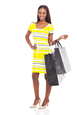 attractive young african woman with shopping bags isolated on white photo