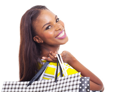close up portrait of young african american model holding shopping bags isolated on white photo