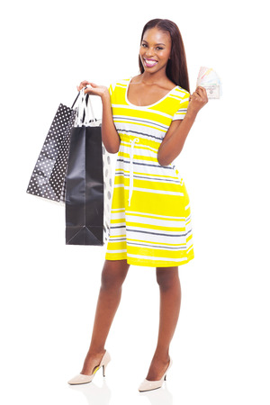 beautiful young african american woman with cash to spend on shopping spree photo