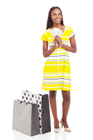 pretty african american woman holding cash to spend on shopping Stock Photo - 22377665
