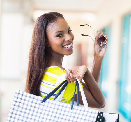 shopping center: happy attractive african shopper in shopping mall Stock Photo