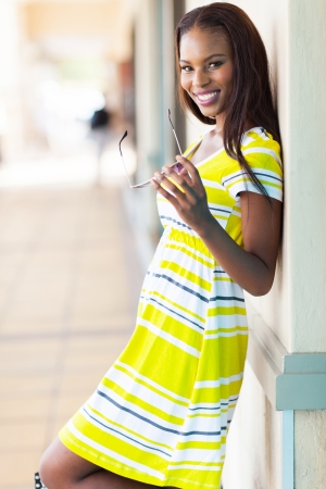 cheerful african woman in shopping center photo