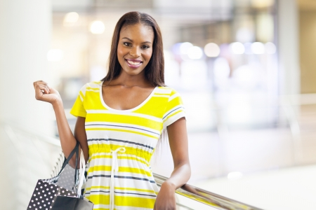 attractive african american woman in shopping mall photo