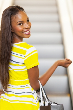 beautiful african woman going shopping in mall photo