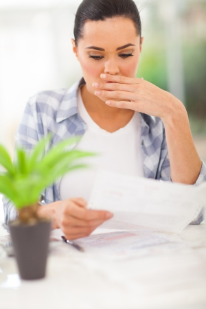 monthly salary: young woman got shocked when receive her monthly bank statement