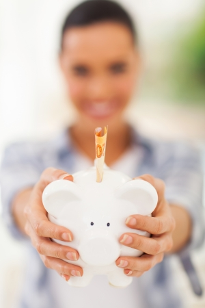 woman holding piggybank with banknote Stock Photo - 22404500