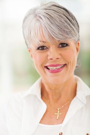smiling elegant mature caucasian woman close up photo