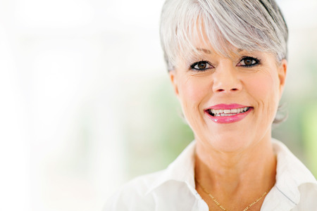 middle aged: close up portrait of beautiful middle aged woman indoors