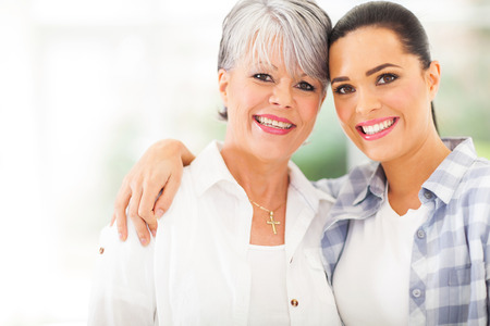 beautiful mother: portrait of beautiful mature mother and young daughter
