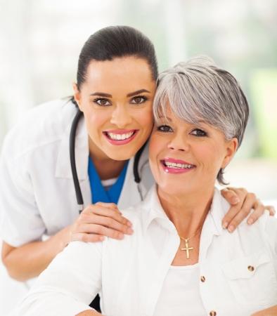 happy nurse: portrait of friendly medical nurse and senior patient