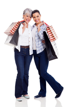 happy senior mother and daughter holding shopping bags isolated on white photo