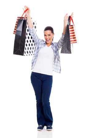 lovely woman with shopping bags isolated on white photo