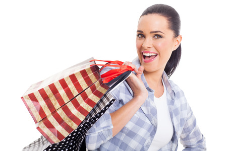 pretty woman holding shopping bags on white background photo