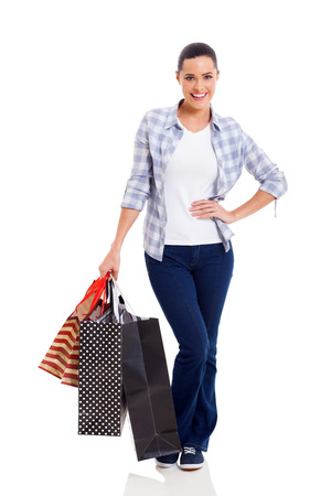 attractive young woman carrying shopping bags on white background photo