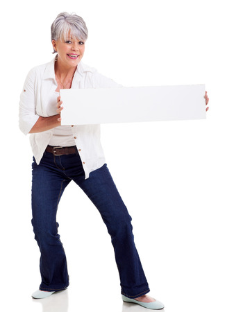 funny mature woman presenting blank banner isolated on white photo