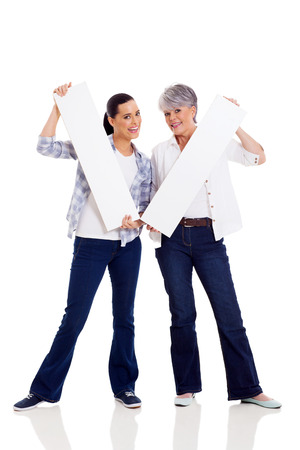 happy middle aged mother and daughter holding white boards photo