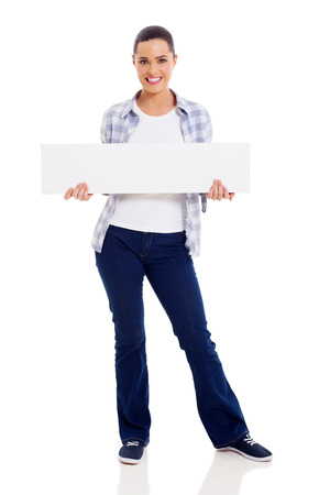 pretty young woman in casual clothes holding blank banner photo