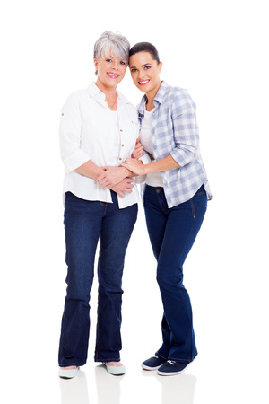 middle aged mother and young adult daughter isolated on white photo
