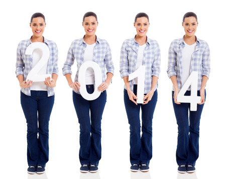 pretty young woman holding numbers of 2014 isolated on white photo