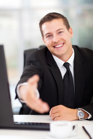 happy businessman offering handshake in office photo