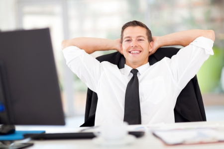 portrait of young businessman relaxed in office
