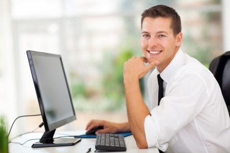 relaxed businessman sitting in modern office photo
