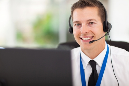 support services: smiling male customer support operator with headset