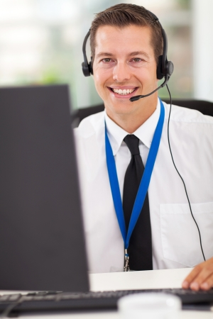 call center office: happy technical call center operator with headphones