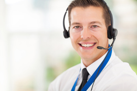 technical support: successful male call centre employee wearing a headset