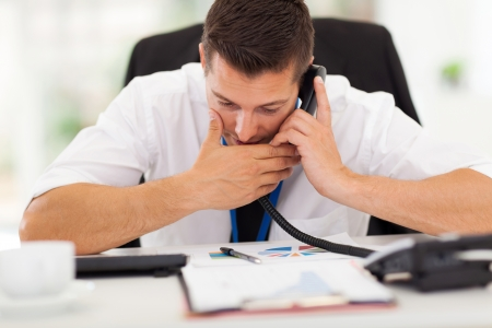 office worker making a private call with a company phone