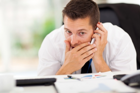 personal call: businessman taking a private call during working hour