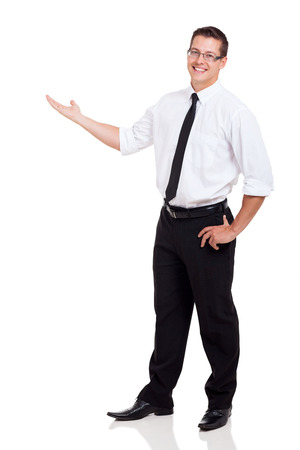 welcoming: friendly businessman with arm out in a welcoming gesture