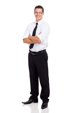 businessman standing: young businessman standing with arms crossed on white background