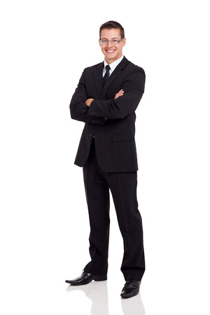 work suit: friendly business man in a suit with arms folded isolated on white
