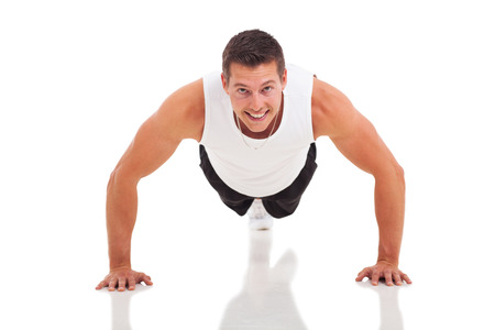 fitness man doing push ups over white background photo