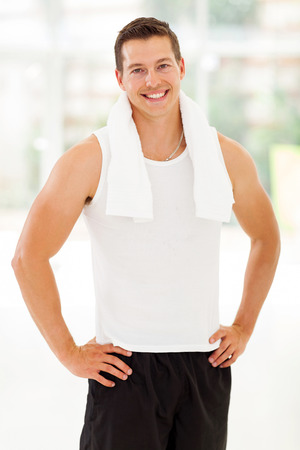 sportive: handsome sportive young man in gym