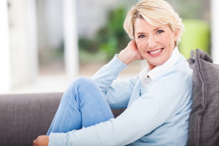 attractive middle aged woman relaxing at home