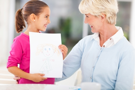 loving little granddaughter showing drawing of her granny Stock Photo - 22889898