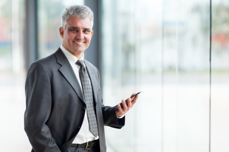 well dressed  holding: portrait of senior business executive using tablet pc Stock Photo