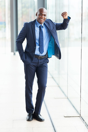 young african american businessman full length portrait in office photo