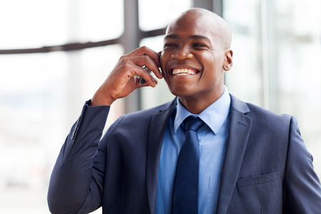 navy blue suit: handsome african american business executive talking on cellphone Stock Photo