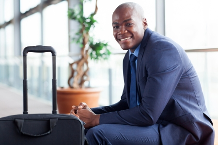 navy blue suit: handsome african american businessman waiting in airport