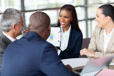 african business people: cheerful business group having monthly meeting Stock Photo