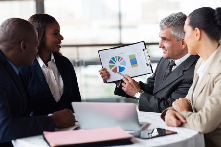 successful senior businessman showing a graph to his business team Stock Photo - 23152746