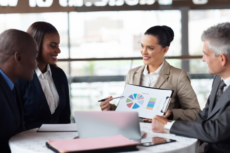 portrait of business team discussing market share in a meeting Stock Photo - 23152750