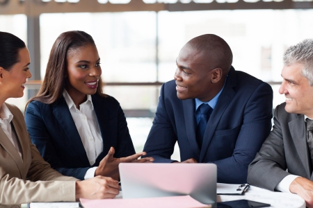 african american: group of successful business people having meeting together