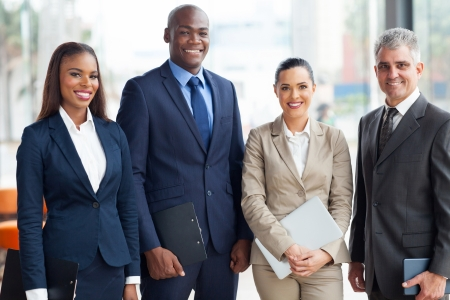 mature people: portrait of multiracial business team in office