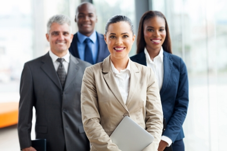 ethnic diversity: group of businesspeople standing together in office