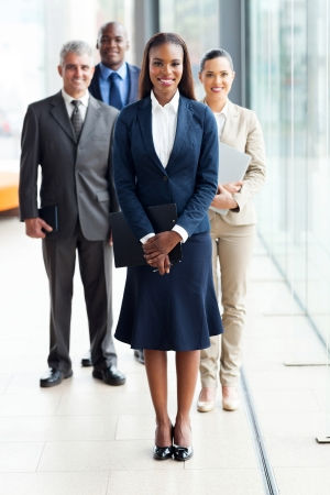 beautiful African female business leader with team standing